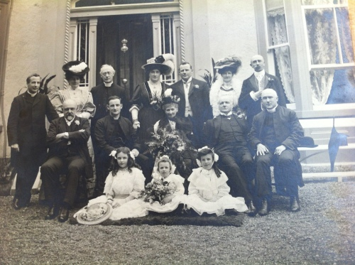 A photo of the Doyle family, taken in 1907, shortly after Fr Doyle's ordination. The occasion is his parents' 50th wedding anniversary. Hugh and Christina Doyle can be seen in the centre of the middle row.